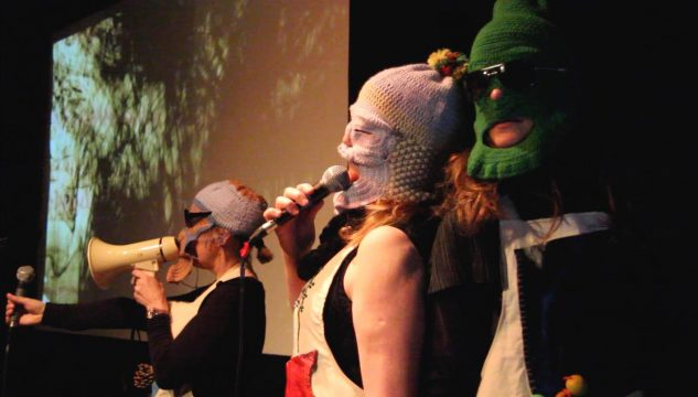 Image of Hayley Newman singing as part of The Gluts