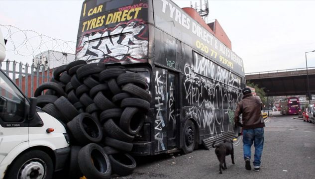 Image of bus and pile of tyres