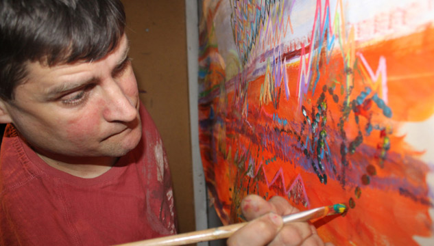 David James working on a painting