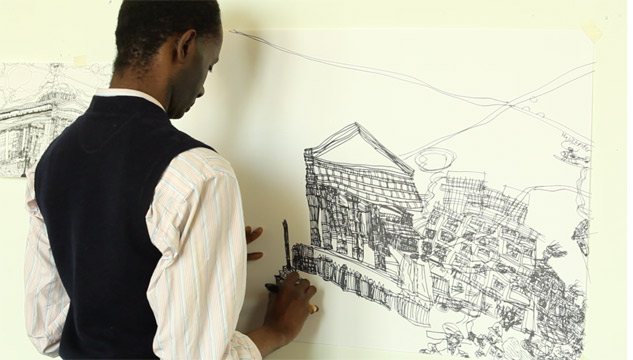 The artist Leslie Thompson working on a drawing of a building