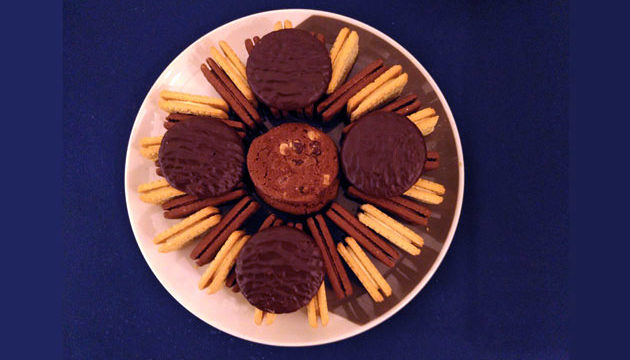 Plate of biscuits - bourbons, custard creams, jaffa cakes - arranged artistically