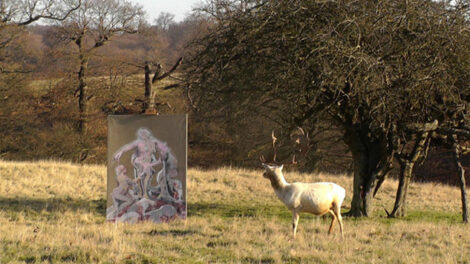 Photograph of stag looking at painting, in a rural landscape