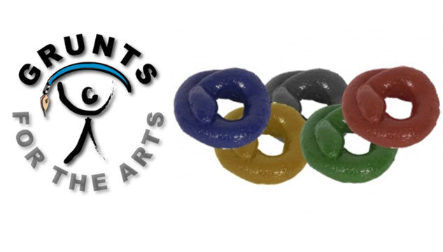 A logo for Grunts for the Arts, including Olympic rings made out of something squidgy